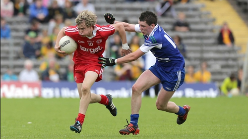 Shane Conlon of Monaghan in hot pursuit of Tyrone's Kieran McGeary in Clones