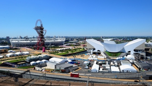 The Aquatic Centre (right) played host to the Games opening swimming action on Saturday