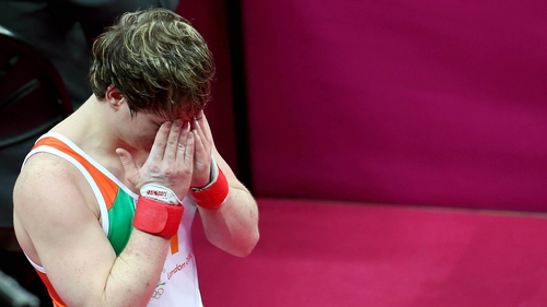 Kieran Behan holds his head in his hands after the floor event