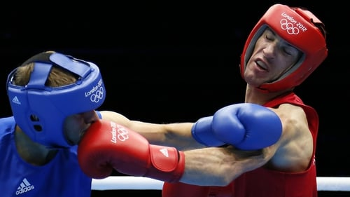 John Joe Nevin (red) proved far too strong for first-round opponent Denis Ceylan