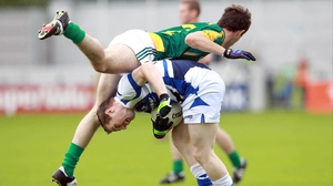 Meath's Donal Keogan goes over the top of Colm Kelly of Laois