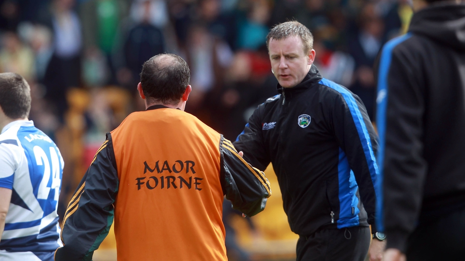 McEnaney shakes hands with Laois manager Justin McNulty at the end of the game