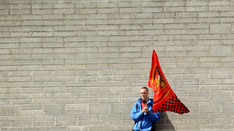 A Down fan awaiting the start of the game at Cusack Park in Mullingar