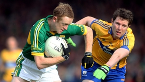 Colm Cooper (who became Kerry's record scorer during the match) is pursued by Kevin Harnett of Clare