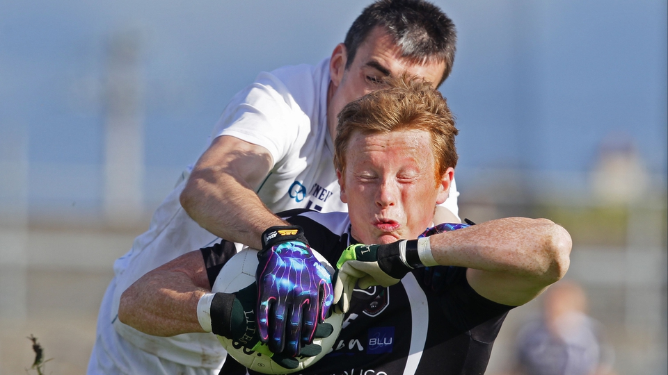 Kildare captain Johnny Doyle tackles Charlie Harrison of Sligo
