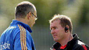 Down manager James McCartan (r) commiserates with his Tipperary counterpart Peter Creedon