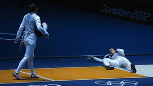 Germany's Carolin Golubytskyi lies prone after being struck by eventual gold medallist Elisa Di Francisca