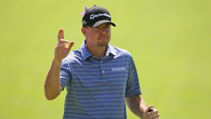 Robert Garrigus will take a small advantage into the final round in Canada