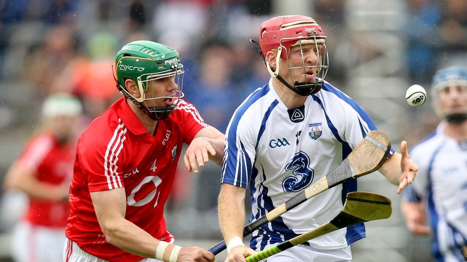 Cork's Brian Murphy chases down John Mullane of Waterford
