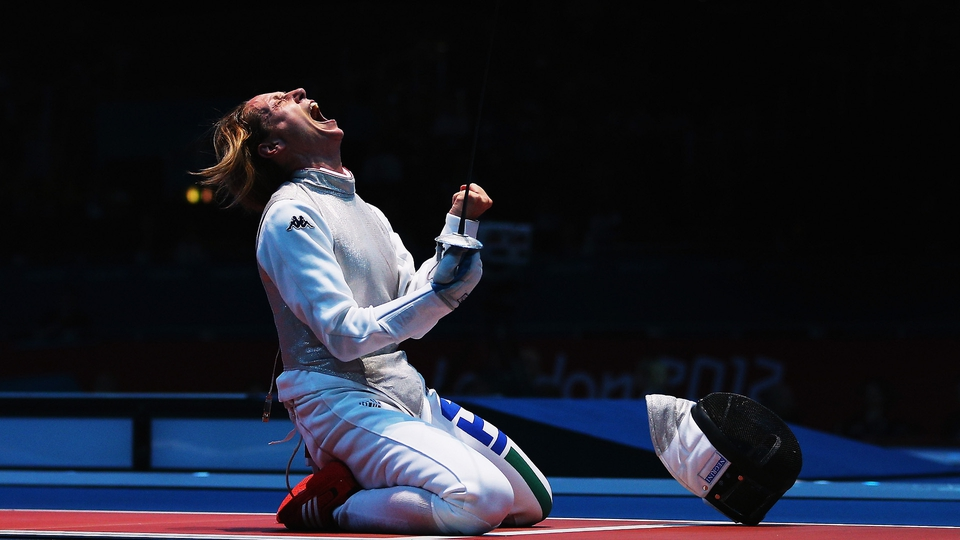 Valentina Vezzali celebrates winning her Women's Foil Individual Fencing Quaterfinal match against Ines Boubakri of Tunisia