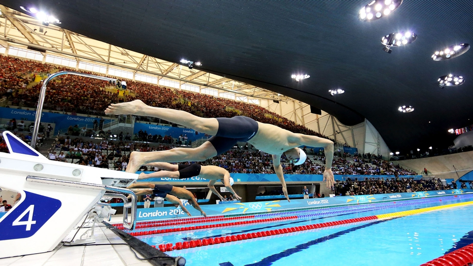 Sun Yang of China dives off of the starting block as he competes in heat four of the Men's 400m Freestyle