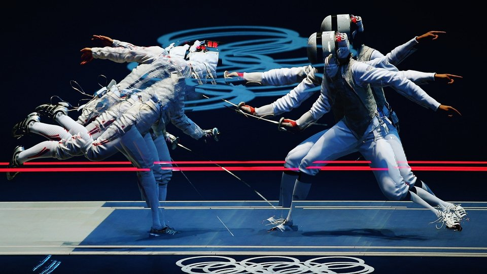 Carolin Golubytskyi of Germany competes against Elisa Di Francisca of Italy in their Women's Foil Individual Fencing round of 16 match