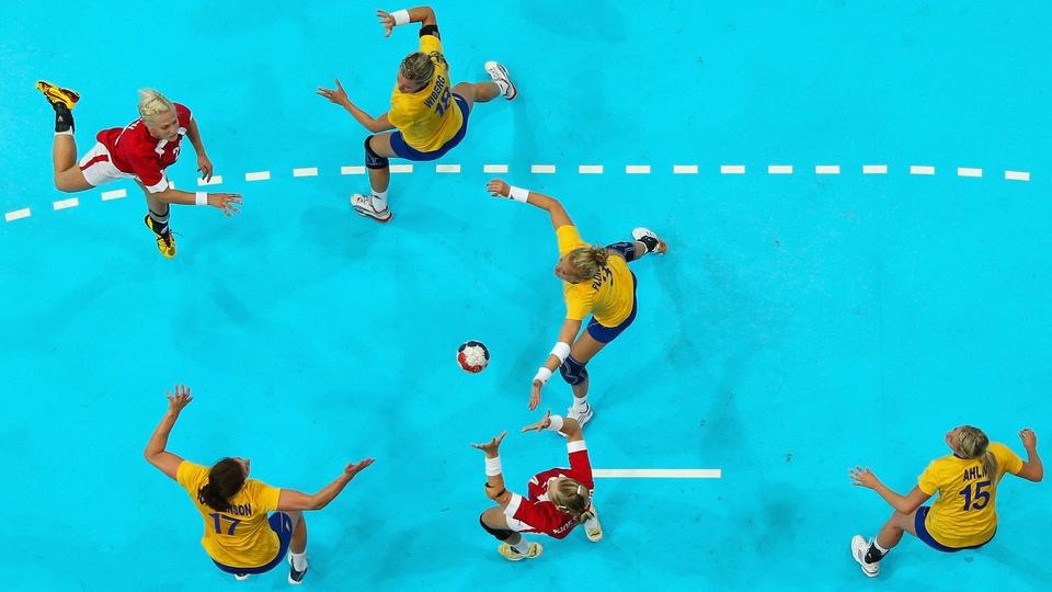Rikke Skov of Denmark passes the ball in the Women's Handball preliminaries Group B - Match 4 between Denmark and Sweden