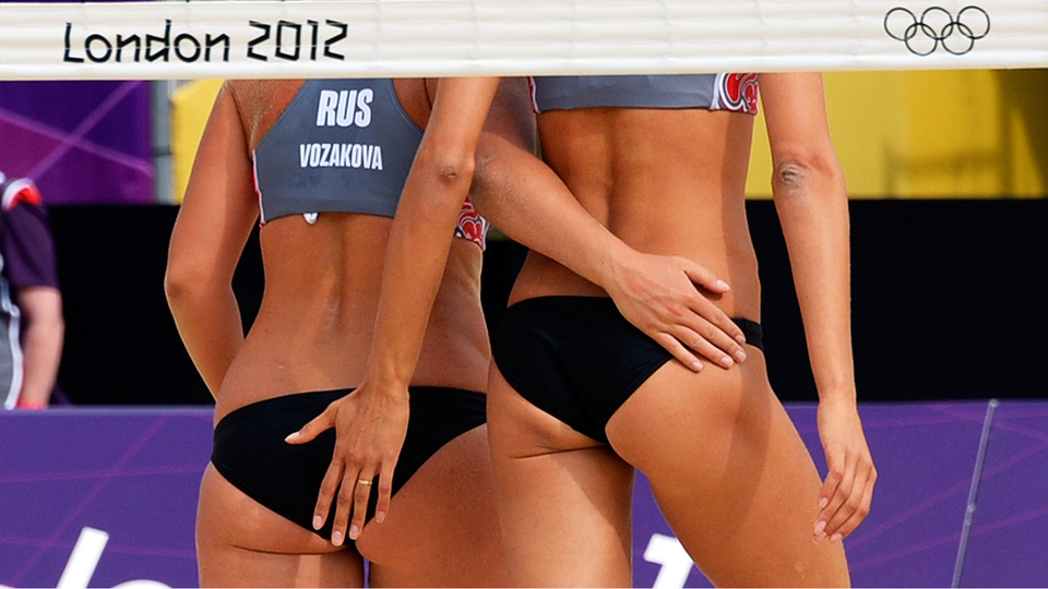 Russia's Anna Vozakova and Anastasia Vasina celebrate in the women's beach volleyball preliminary phase - Pool B match