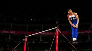 Louis Smith of Great Britain competes in the horizontal bars in the Artistic Gymnastics Men's Team qualification