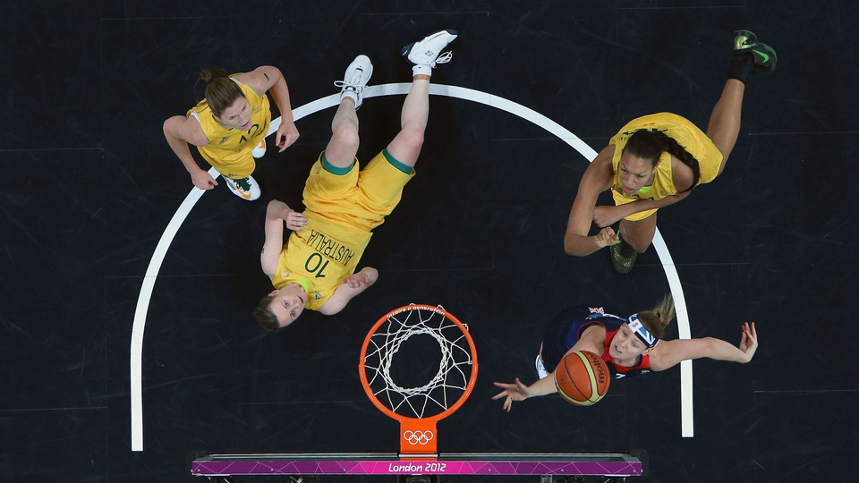 Rachael Vanderwal of Great Britain shoots against Kristi Harrower of Australia in the second half during the Women's Basketball clash