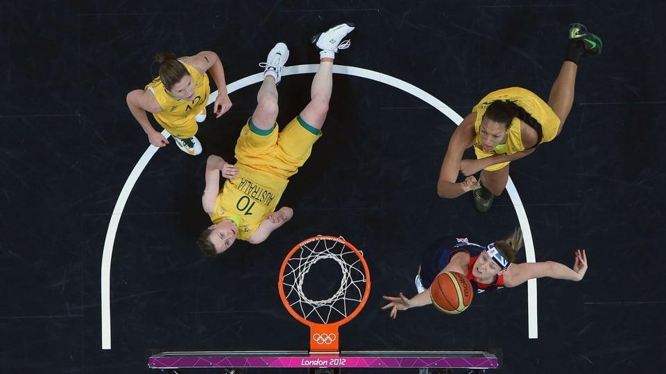 Rachael Vanderwal of Great Britain shoots against Kristi Harrower of Australia in the second half during the Women's Basketball clash