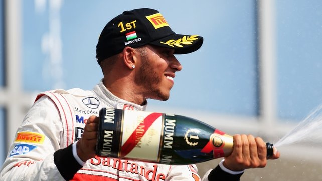 Lewis Hamilton celebrates his win in Hungary