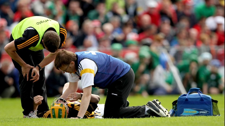 Kilkenny's Richie Power is laid out after being on the receiving end of a shuddering Wayne McNamara shoulder