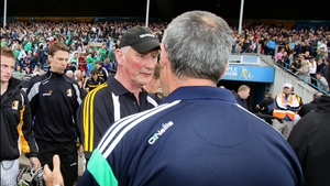 Limerick boss John Allen congratulates Cody after the final whistle blew on Kilkenny's 4-16 to 1-16 victory