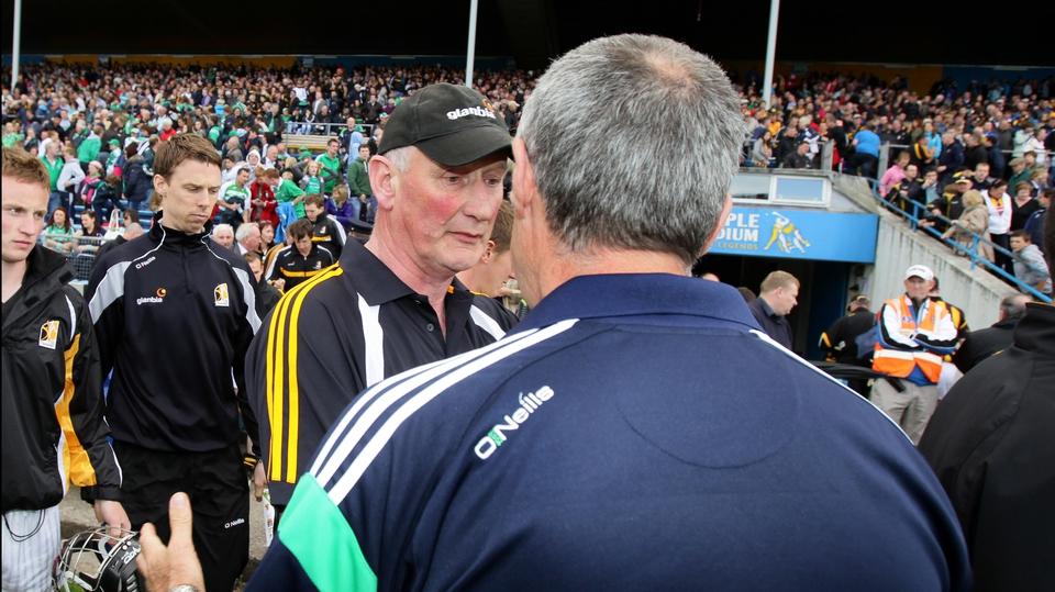 Cody shakes hands with Limerick boss John Allen after the final whistle went to confirm Kilkenny's 4-16 to 1-16 victory
