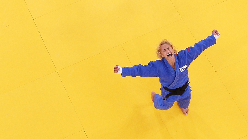 Rosalba Forciniti of Italy celebrates winning the bronze medal in Judo