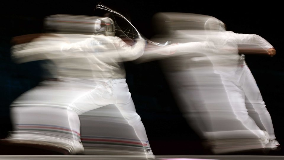 Aron Szilagyi (left) of Hungary competes against Nikolay Kovalev of Russia during their men's sabre individual semi-final
