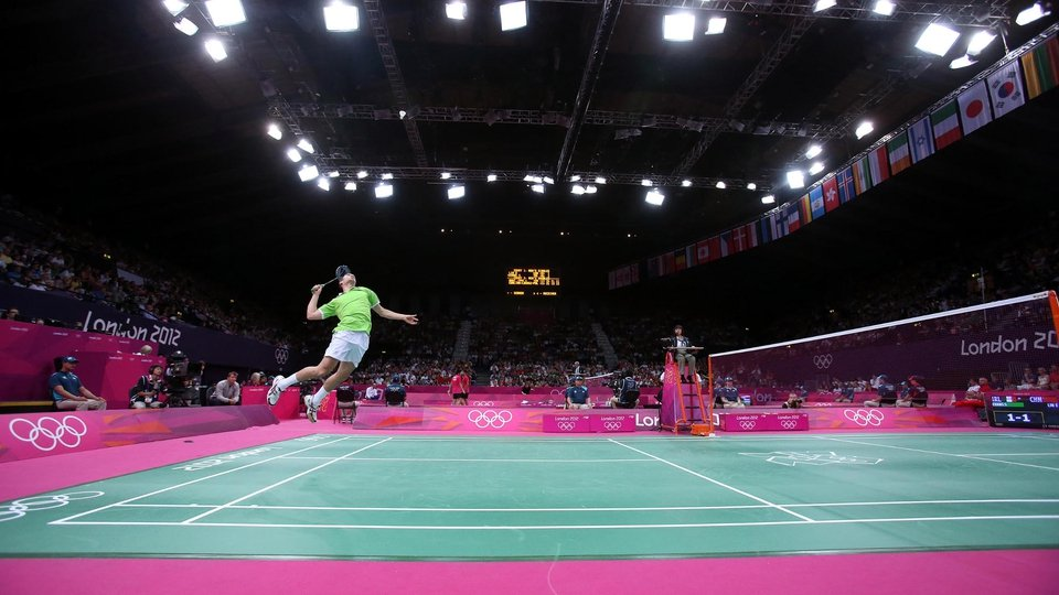 Scott Evans of Ireland stretches to reach the shuttlecock in his clash with China's  Lin Dan