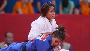 Kaori Matsumoto of Japan (white) competes with Kifayat Gasimova of Azerbaijan