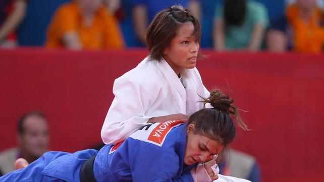 Kaori Matsumoto of Japan (white) competes with Kifayat Gasimova of Azerbaijan