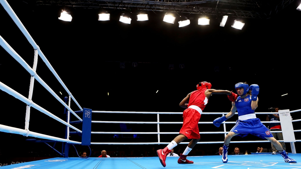 Oteng Oteng of Botswana throws a punch at Jeyvier Cintron Ocasio of Puerto Rico in the Men's Fly (52kg) Boxing