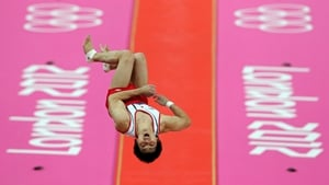 Koji Yamamuro of Japan competes on the vault in the Artistic Gymnastics Men's Team final