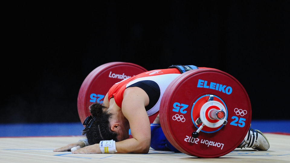Romela Begaj of Albania collapses in the Women's 58kg Weightlifting