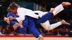 Hedvig Karakas of Hungary tackles Corina Caprioriu of Romania during the Women's -57 kg Judo