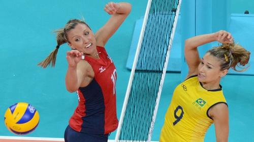 Brazil's Fernanda Ferreira (R) spikes the ball as US player Jordan Larson attempts to block in tonight's pool match