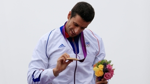 Tony Estanguet admires his gold medal