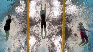 Jemma Lowe of Great Britain, Zige Liu of China and Zsuzanna Jakabos of Hungary battle it out in the Women's 200m Butterfly