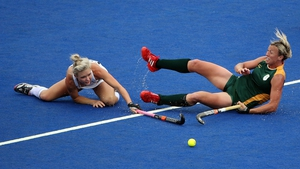 Charlotte Harrison of New Zealand challenges Tarryn Bright of South Africa during the Women's Hockey
