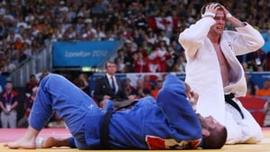 Antoine Valois-Fortier of Canada is overcome as he defeats Travis Stevens of the US in the Men's -81 kg Judo