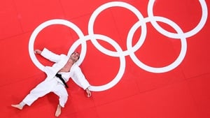 Emmanuel Lucenti of Argentina lies defeated in the Men's -81 kg Judo