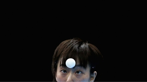 Kasumi Ishikawa of Japan keeps her eye on the ball during the Women's Singles Table Tennis