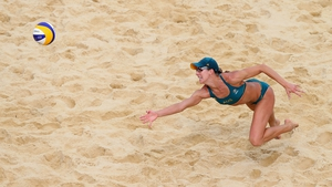 Louise Bawden of Australia dives for the ball during the Women's Beach Volleyball match between Australia and the Netherlands