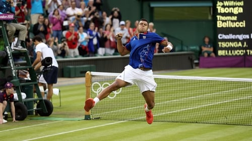An ebullient Jo-Wilfried Tsonga celebrates finally crossing the finish line in his clash with Milos Raonic