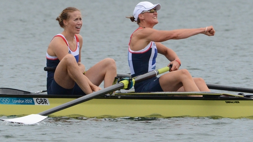 Helen Glover (L) and Heather Stanning celebrate their victory