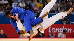 Britain's Winston Gordon takes down Alexandre Emond of Canada in their Men's Judo bout