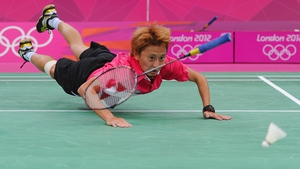 Shao Chieh Cheng of Chinese Taipei dives in vain to reach the shuttlecock in the Women's Singles Badminton