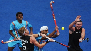 A battle for the ball during the Hockey clash between New Zealand and India