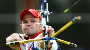 Alan Wills of Great Britain has his eye on the target in his Men's Individual Archery Elimination match