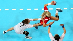 Linn Jorum Sulland tries to get her shot in during the handball match between Norway and Korea