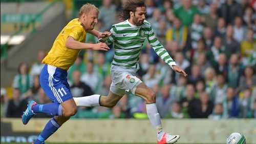 Georgios Samaras of Celtic goes around HJK's Mathias Lindstrom at Celtic Park